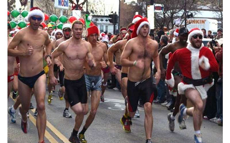 shirtless men running