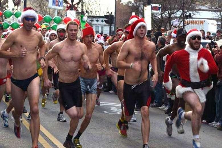 shirtless men running