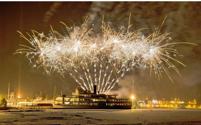 fireworks above a cruise ship