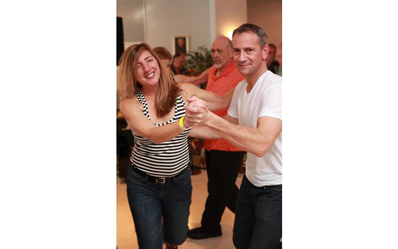 two people dancing to polka music