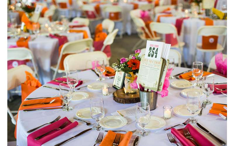 tables with plates and silverware