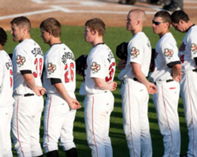 baseball players standing for national anthem