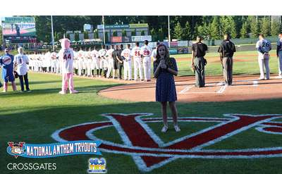 girl singing the national anthem at a valleycats game