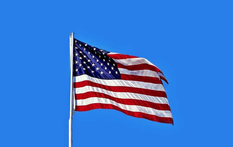 an American flag against blue sky