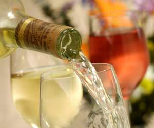 bottle of sparking wine pouring into glass