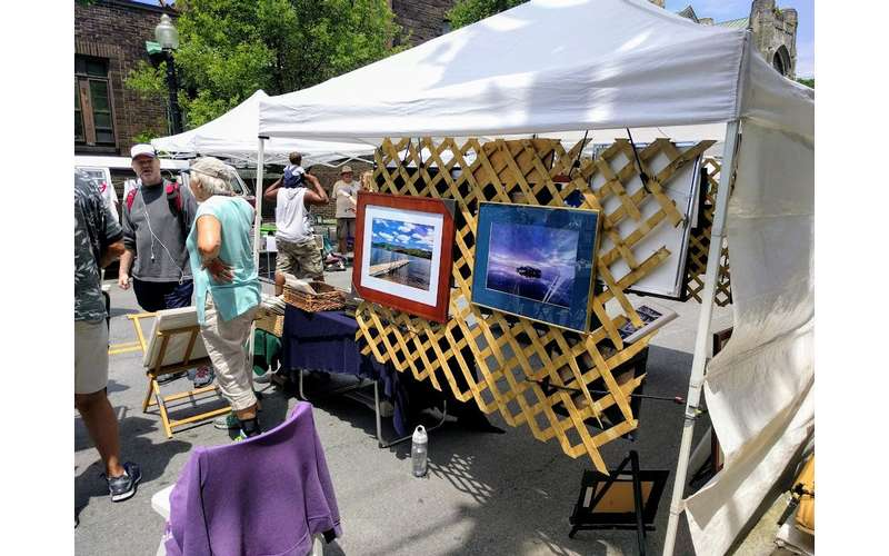 vendor booth with paintings