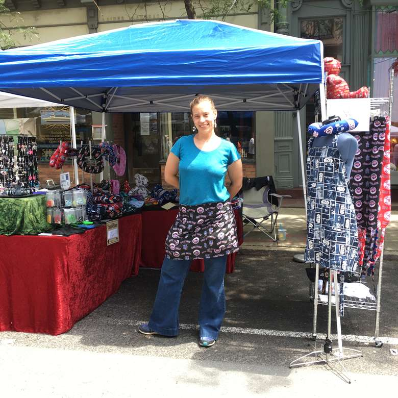 woman in front of vendor booth