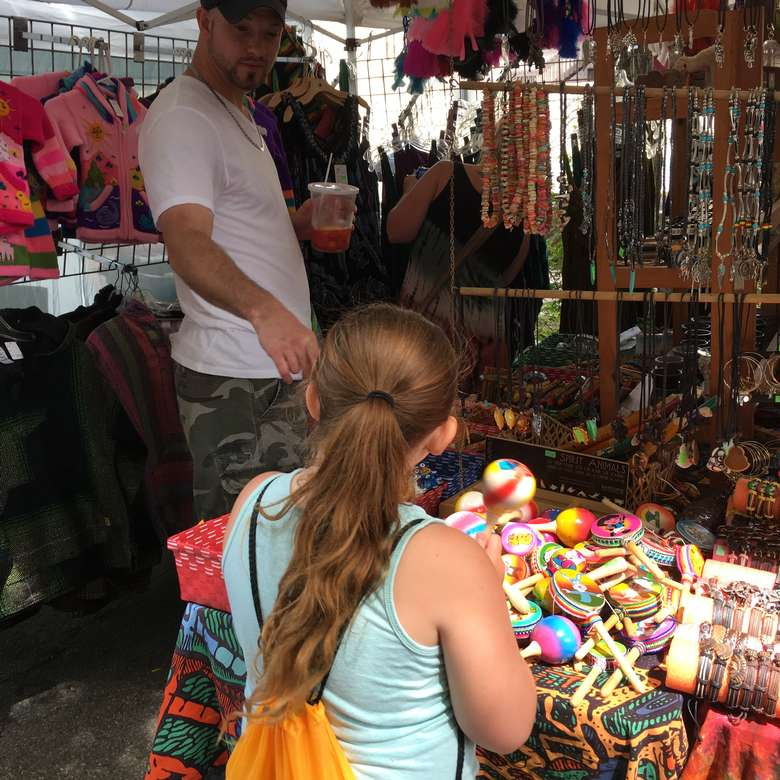 little girl at vendor booth
