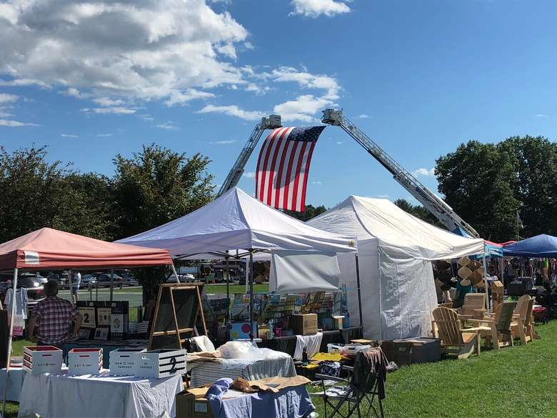 vendor tents and american flag in the background