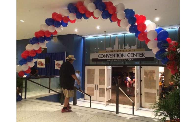 balloons surrounding a convention center door