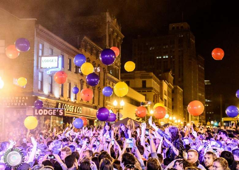 crowd of people with balloons