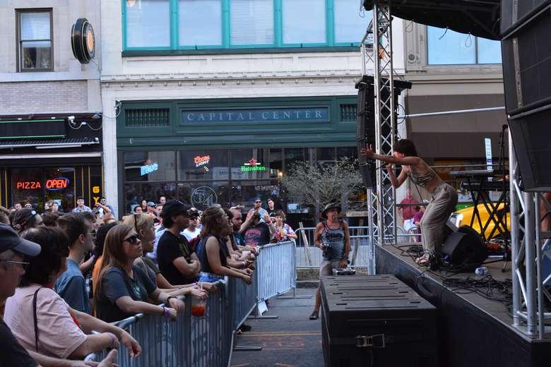 people attending an outdoor concert