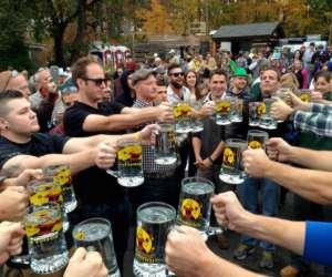 people with oktoberfest beer steins
