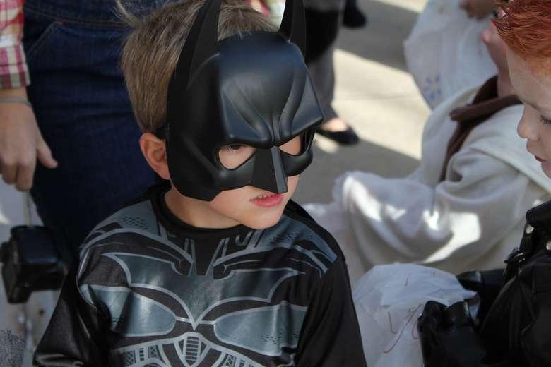 little boy in Bathman costume
