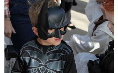 little boy in Bathman costume