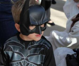 kid in Batman costume