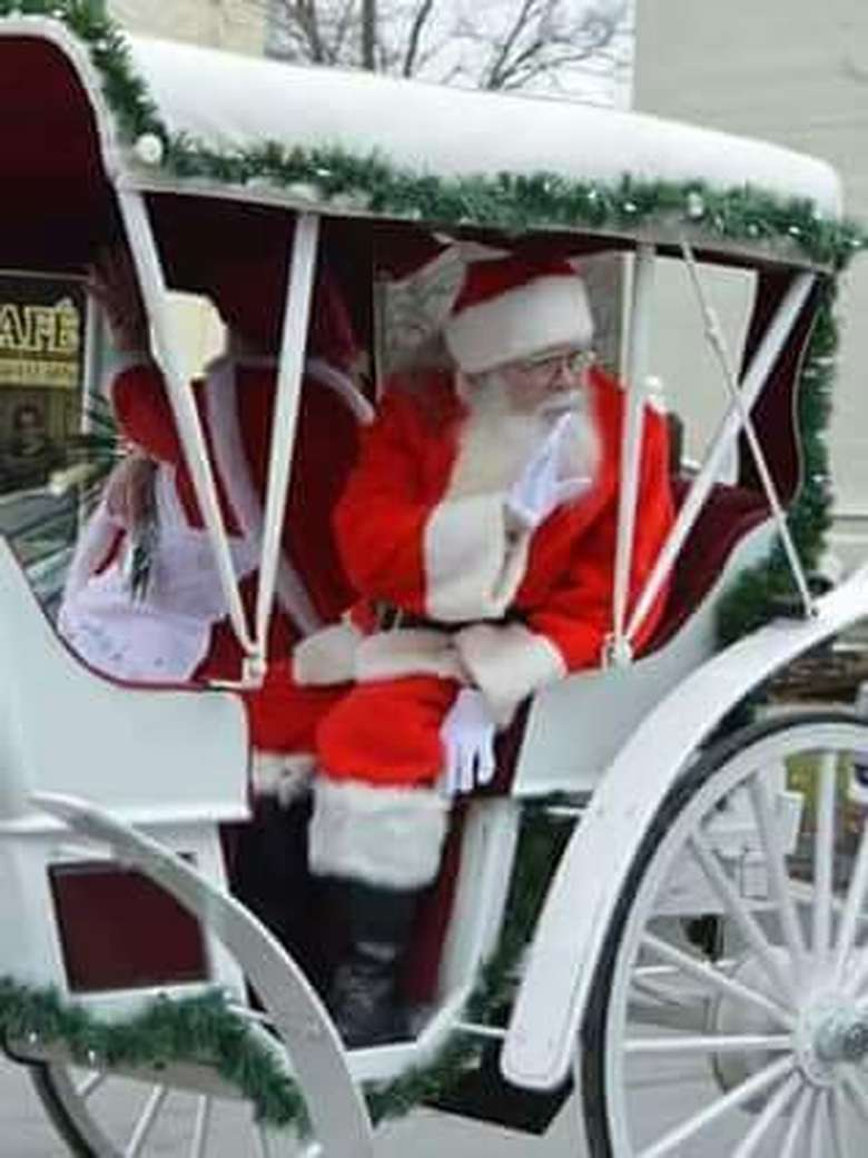 santa in an enclosed carriage