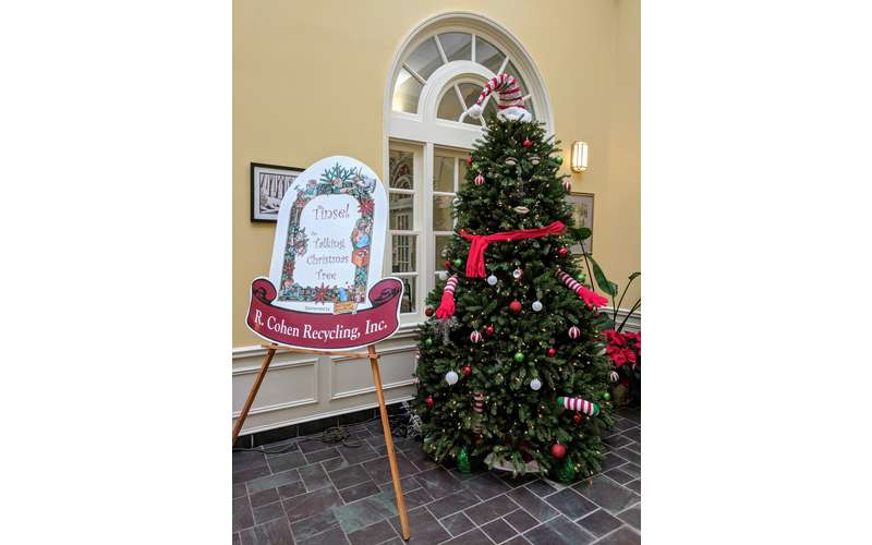 Christmas tree at entrance of event