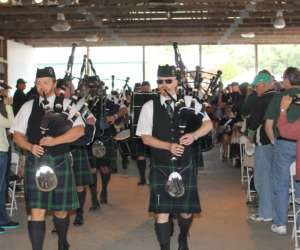 men in kilts playing bagpipes