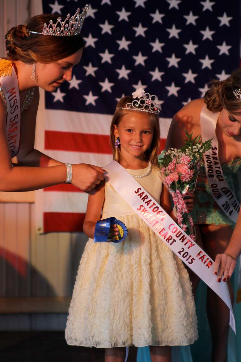 little girl getting crowned