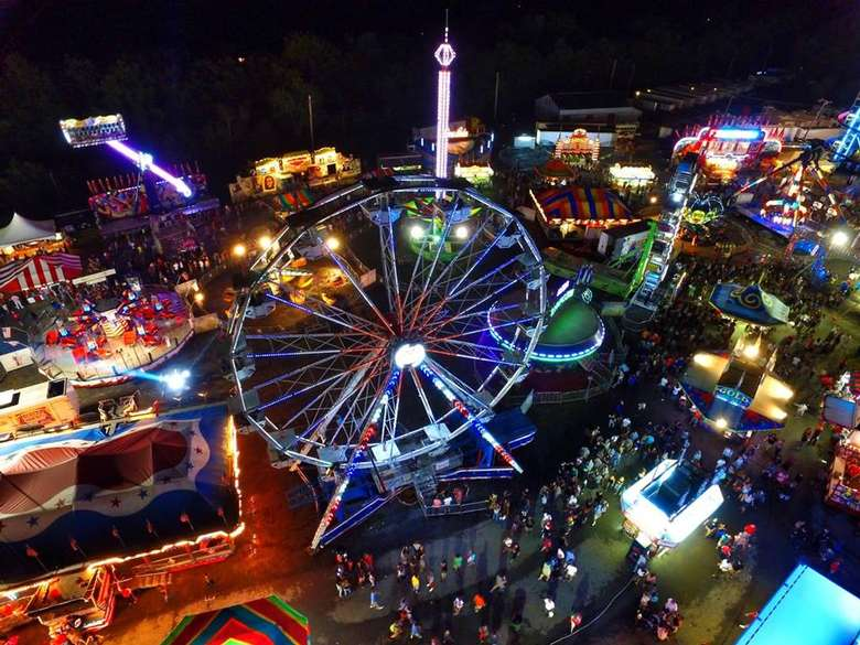 aerial view of a colorful fair midway at night