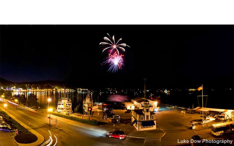 fireworks going off over lake george