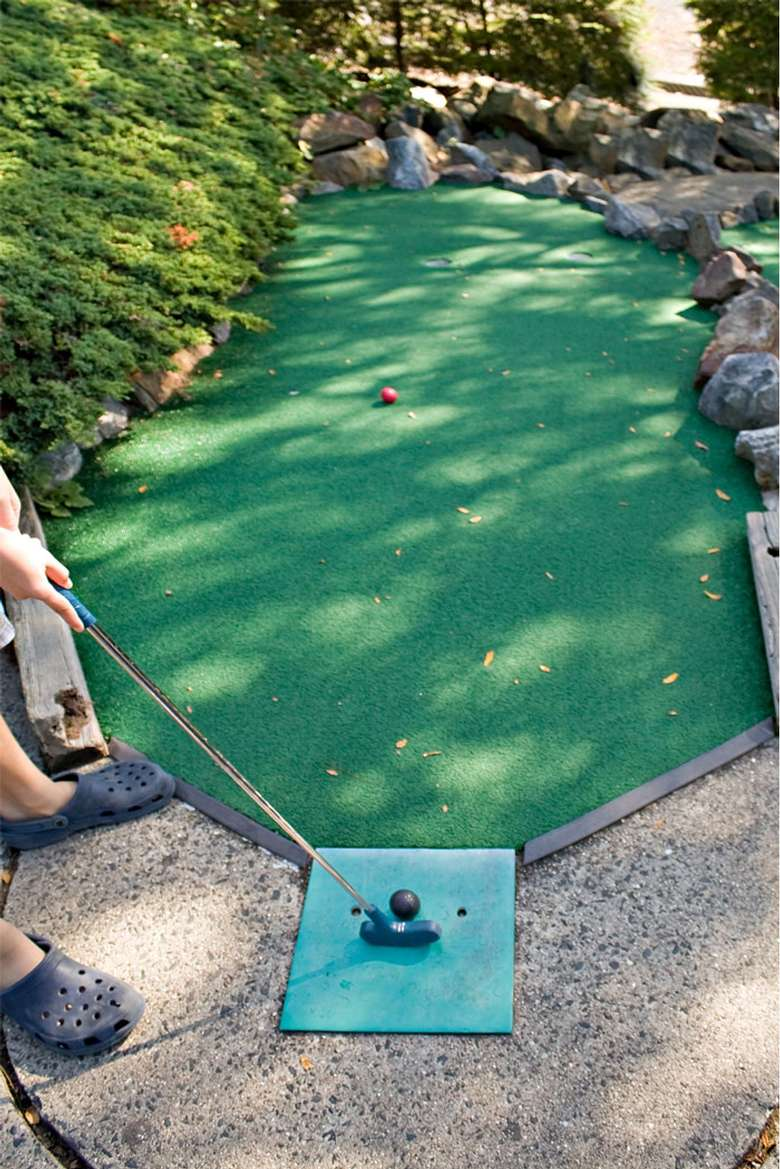 person playing mini golf