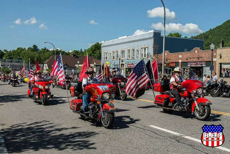 parade of motorcycles with american flags