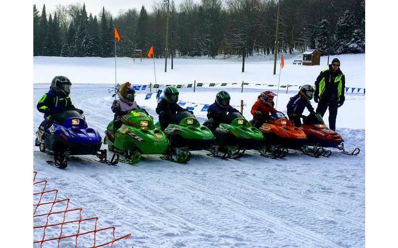 kids on snowmobiles lined up