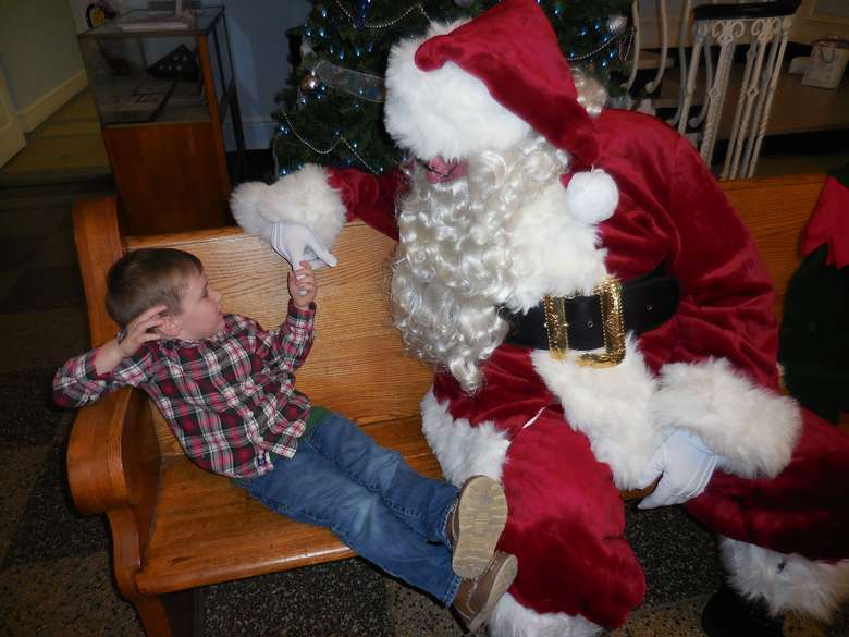 a child visiting with santa