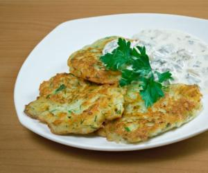 latkes on a plate with white sauce