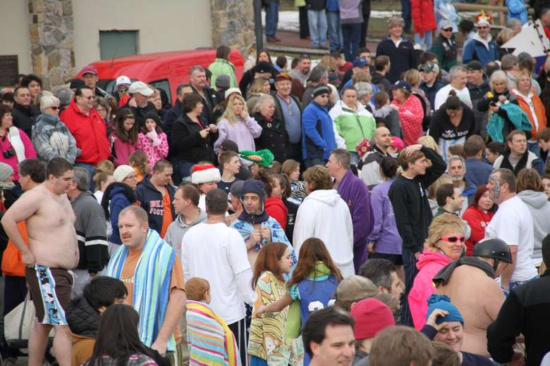 a large group of people preparing for a polar plunge
