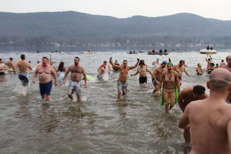 crowd of people in a cold lake