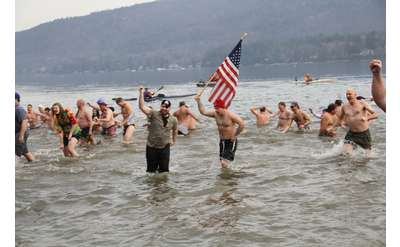 people in a lake for a polar plunge