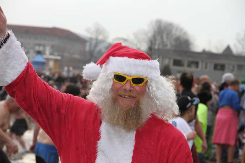 man dressed as santa with sunglasses