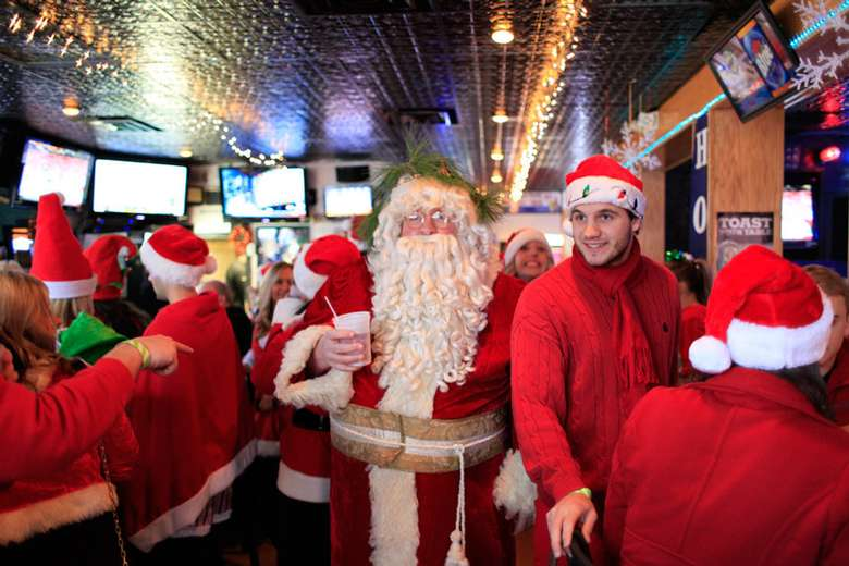 santa and people in holiday outfits