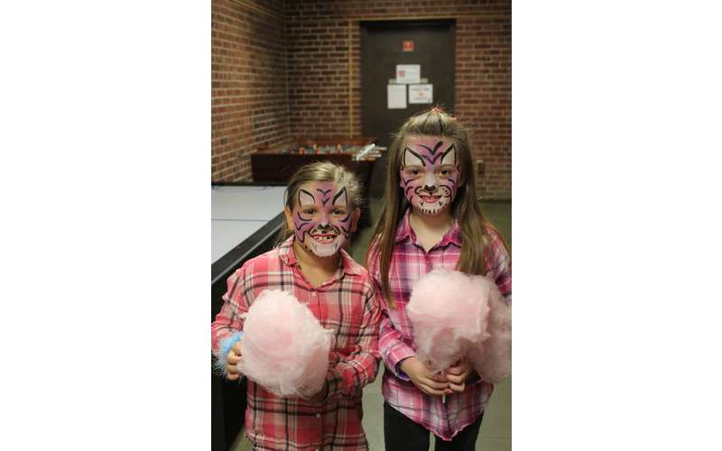 two girls holding cotton candy