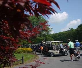 people walking to golf cart