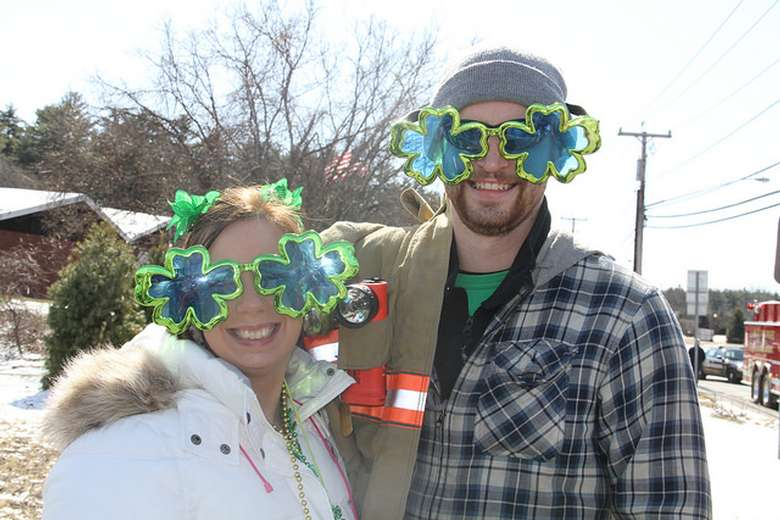 a man and woman with shamrock glasses