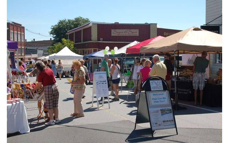 vendor tents set up on the street for Ticonderoga's Streetfest