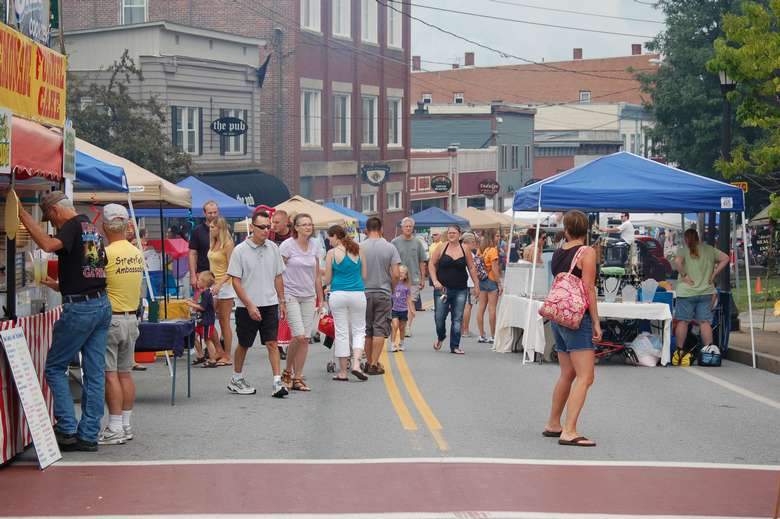 a large group of people on the street for Streetfest in Ticonderoga