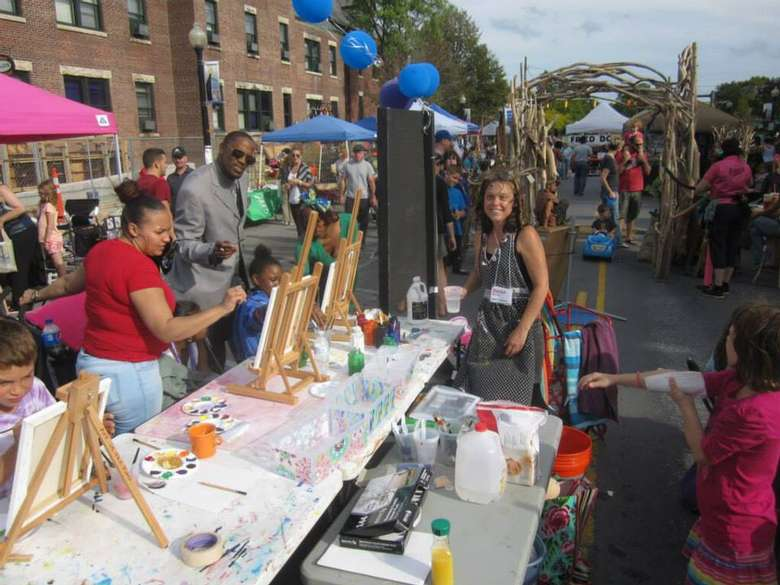 a street fair with people paitning