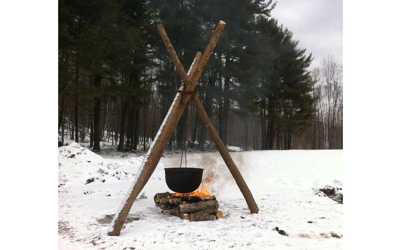 maple sugar boiling over a fire