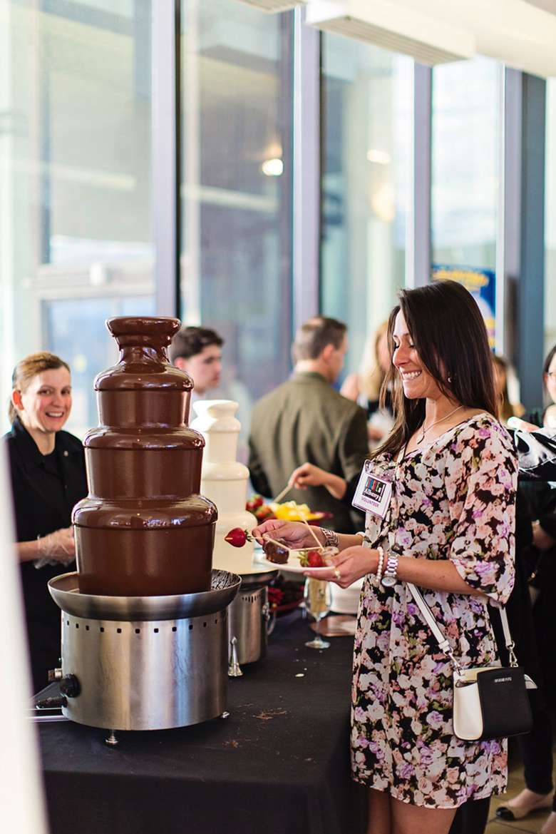 woman in front of chocolate fountain