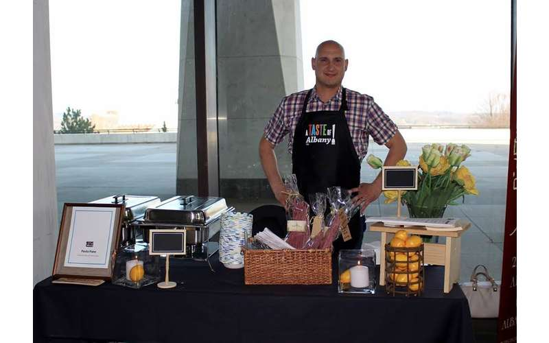 a man standing being a vendor table