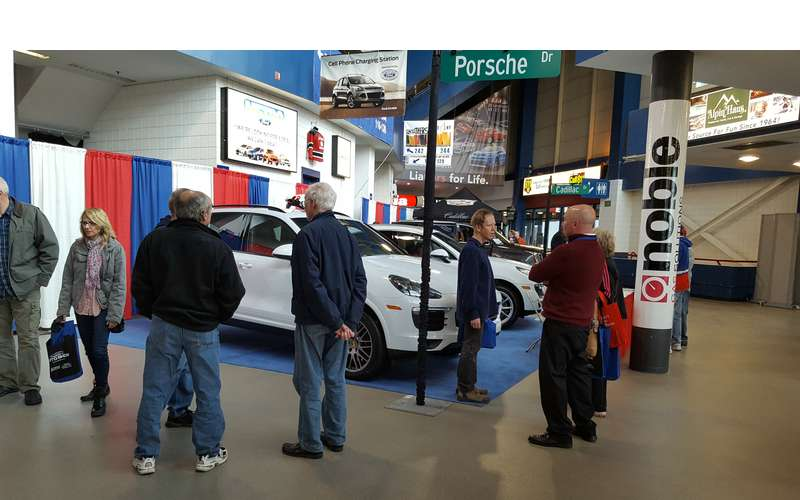 people looking at show cars