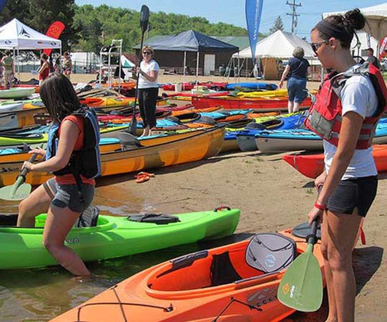 two women, one about to get into a kayak