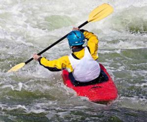 a kayaker in rapids