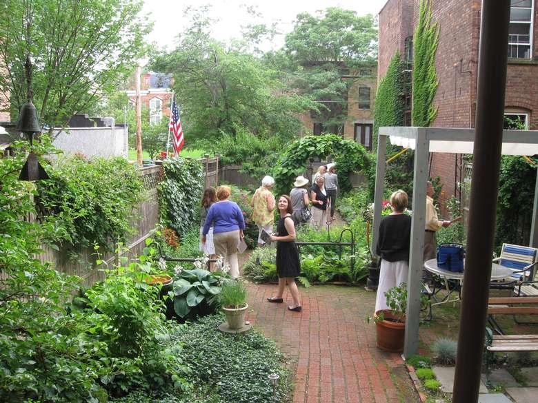 people on a tour through a garden