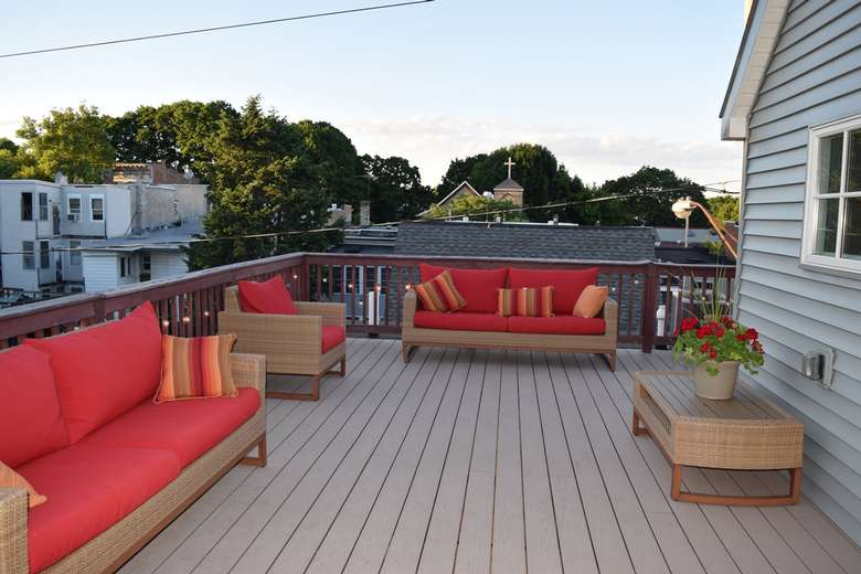huge deck with red furniture
